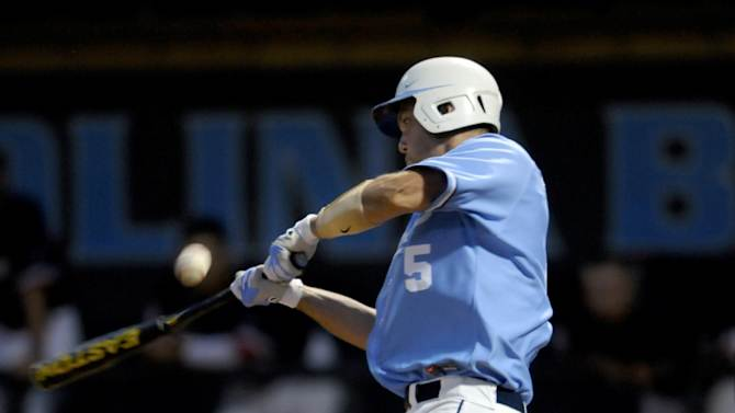 North Carolina's Jacob Stallings (5) misses the ball during the seventh inning of an NCAA regional tournament college baseball game against St. John's, Sunday June 3, 2012, in Chapel Hill, N.C. St. John's won 9-5. (AP Photo/Sara D. Davis)