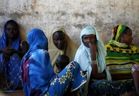 Internally displaced women from Bangui attend a community meeting in Bambari