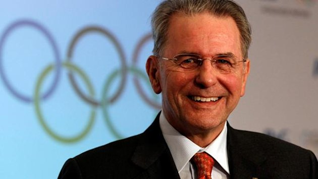 IOC President Rogge smiles during a news conference announcing the IOC partnership with P&G in London