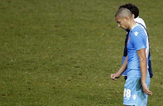 Napoli's midfielder Gokhan Inler, of Switzerland, leaves the pitch at the end of a Serie A soccer match against Atalanta in Bergamo, Italy, Sunday, Feb. 2, 2014. Atalanta won 3-0