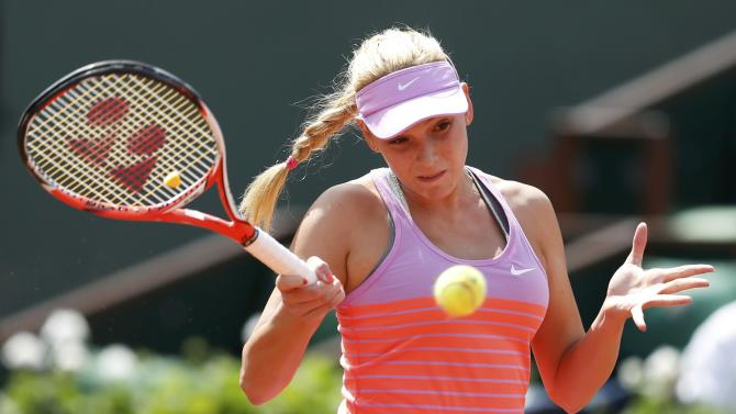 Donna Vekic of Croatia plays a shot to Caroline Garcia of France during the women's singles match at the French Open tennis tournament at the Roland Garros stadium in Paris