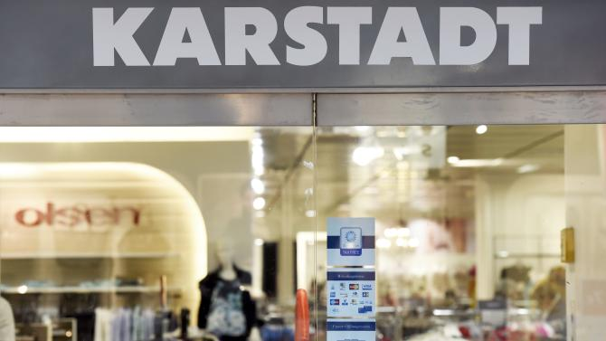 "Closed doors with a slogan reading "" Warm Welcome "" are pictured at a Karstadt department store in Hamburg-Billstedt"