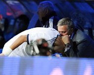 Real Madrid's Portuguese defender Pepe (L) is congratulated by Real Madrid's Portuguese coach Jose Mourinho (R) after scoring during the Spanish league football match Real Madrid against Deportivo at the Santiago Bernabeu stadium in Madrid, on September 30. Mourinho says he wants to return to an English Premier League club after his spell in the Spanish capital comes to an end