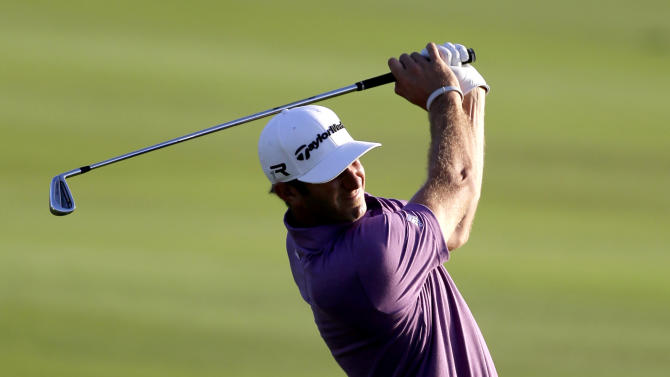 Dustin Johnson hits during the second round at the Tournament of Champions PGA golf tournament, Monday, Jan. 7, 2013, in Kapalua, Hawaii. (AP Photo/Elaine Thompson)