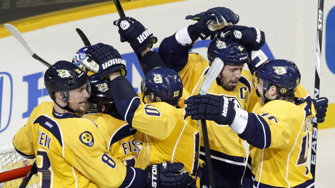 The Nashville Predators celebrate their 2-1 win over the Detroit Red Wings in Game 5 of a first-round NHL Stanley Cup hockey playoff series on Friday, April 20, 2012, in Nashville, Tenn. The Predators won the series 4-1. (AP Photo/Mark Humphrey)