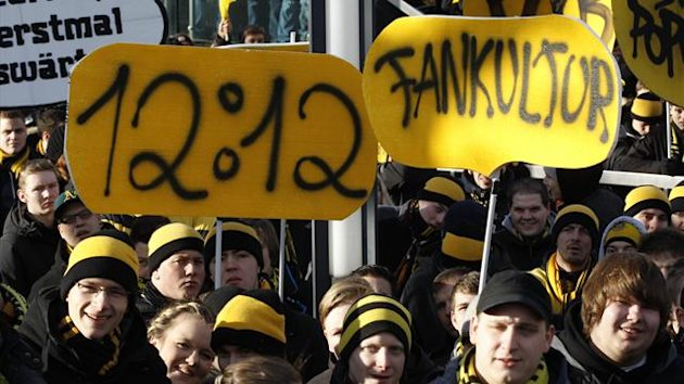 Borussia Dortmund&#39;s supporters hold on signs during a protest before the German first division Bundesliga match against Wolfsburg in Dortmund  (Reuters)