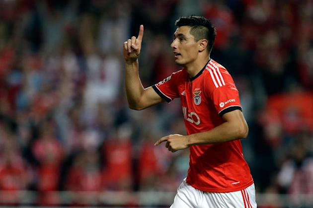 Benfica's Oscar Cardozo, from Paraguay, celebrates after scoring their second goal during their Portuguese league soccer match against Nacional, Sunday Oct. 27, 2013, at Benfica's Luz stadium in Lisbo