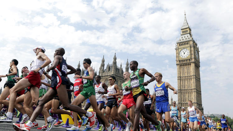Athletes run near Big Ben during the men's marathon at the 2012 Summer Olympics, at the 2012 Summer Olympics, London, Sunday, Aug. 12, 2012. (AP Photo/Luca Bruno)