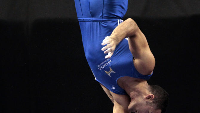 Danell Leyva competes in parallel bars during the men's senior division at the U.S. gymnastics championships, Saturday, June 9, 2012, in St. Louis. (AP Photo/Jeff Roberson)