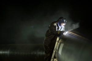 A worker welds the first section of the Gazprom South …