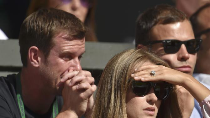 Kim Murray watches her husband, Andy Murray of Britain play his match against Ivo Karlovic of Croatia at the Wimbledon Tennis Championships in London
