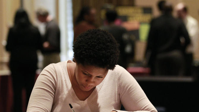 In this Wednesday, Oct. 3, 2012, photo, job hunter Bessie Soley, of Locust Grove, Ga.,  files out an application at the National Job Fair in Atlanta. The number of Americans seeking unemployment benefits rose to a seasonally adjusted 367,000, a level consistent with only modest hiring on Thursday, Oct. 4, 2012. The Labor Department says applications increased last week by 4,000 from the previous week's level of 363,000. (AP Photo/John Bazemore)