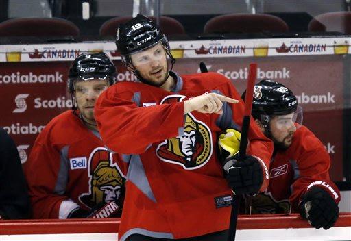 Ottawa Senators Jason Spezza stands in front of Milan Michalek, left, and Cory Conacher, right, during the team's practice ahead of Game 5 in their NHL hockey Stanley Cup playoffs Eastern Conference s