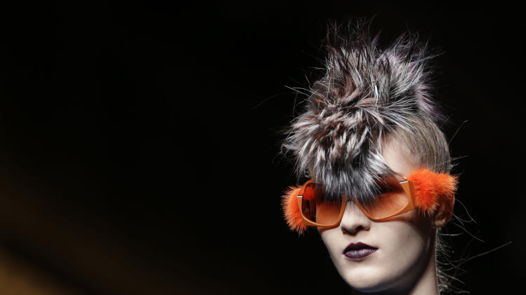 A model wears a creation for Fendi women's Fall-Winter 2013-14 collection, part of the Milan Fashion Week, unveiled in Milan, Italy, Thursday, Feb. 21, 2013. (AP Photo/Luca Bruno)
