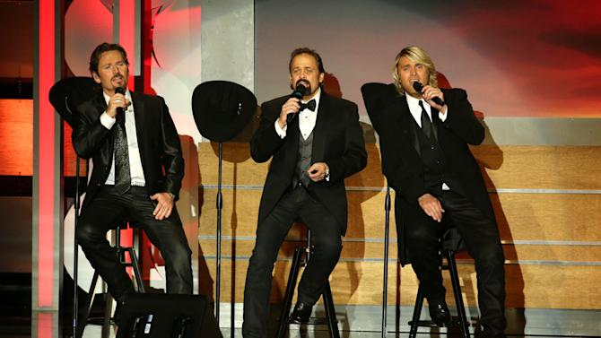 JC Fisher, John Hagen and Marcus Collins of the musical group The Texas Tenors perform on stage at the 28th Annual American Cinematheque Awards Honoring Matthew McConaughey held at The Beverly Hilton on Tuesday, Oct 21, 2014, in Beverly Hills. (Photo by Eric Charbonneau/Invision for American Cinematheque/AP Images)