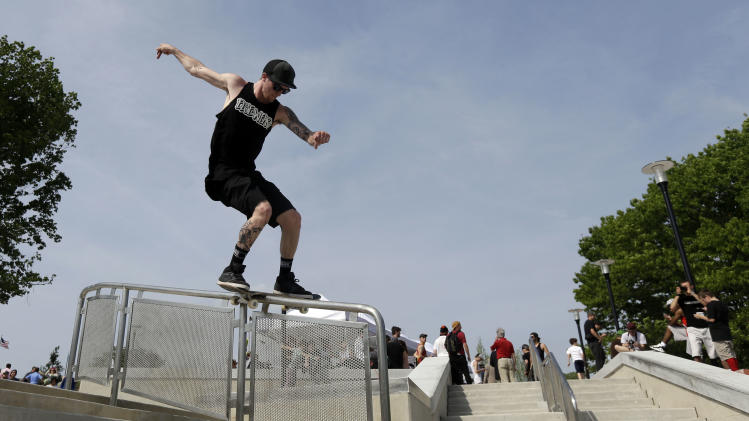 Andrew Ryan Walker does a board slide down a handrail at Paine's Park, Wednesday, May 22, 2013, in Philadelphia. The $4.5 million space, which has been about a dozen years in the making, officially opened to boarders after a ribbon-cutting Wednesday.  (AP Photo/Matt Rourke)