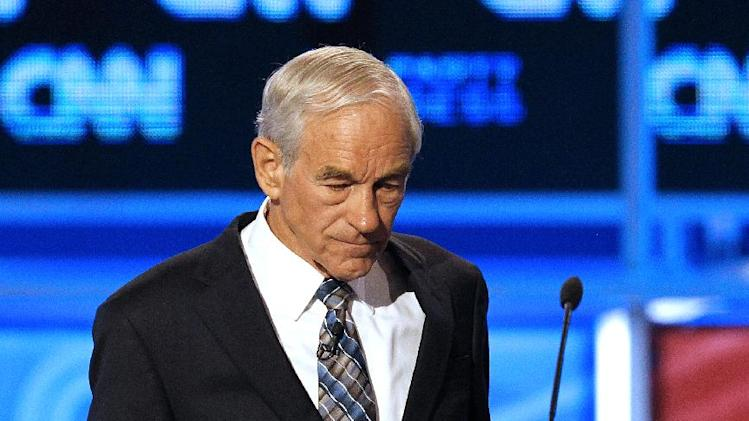 Republican presidential candidate Rep. Ron Paul, R-Texas, pauses during a break in a Republican presidential debate Monday, Sept. 12, 2011, in Tampa, Fla. (AP Photo/Mike Carlson)