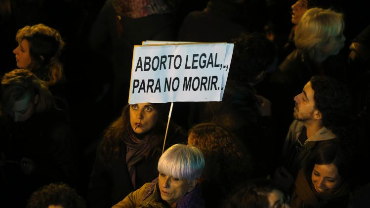 A demonstrator holds a sign during a pro-choice protest against the proposed new abortion law in Madrid