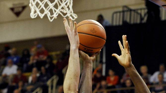 College of Charleston's Adjehi Baru (1) shoots as Davidson's Jake Cohen (15) defends in the first half of an NCAA college basketball game during the Southern Conference tournament, Monday, March 11, 2013, in Asheville, N.C. (AP Photo/Rainier Ehrhardt)
