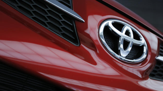 Toyota profit more than doubles on yen, cost cuts