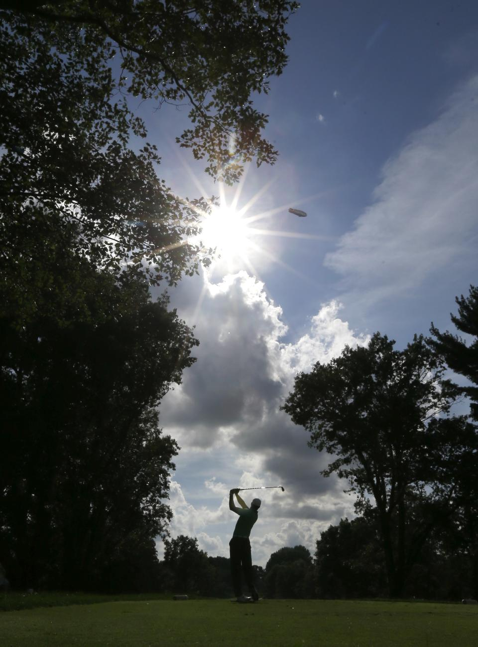 Tiger Woods watches his tee shot on the 13th hole during the second round of the PGA Championship golf tournament at Oak Hill Country Club, Friday, Aug. 9, 2013, in Pittsford, N.Y. (AP Photo/Julio Cortez)