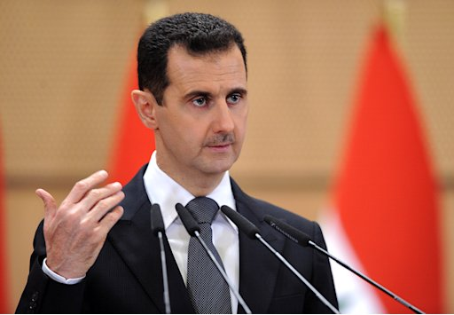 FILE - In this June 20, 2011 file photo released by the Syrian official news agency SANA, Syrian President Bashar Assad delivers a speech in Damascus, Syria, at Damascus University. Facing tenacious uprisings, the leaders of Syria, Libya and Yemen could only have thought of their own possible fates when they saw Hosni Mubarak in a defendants' cage, Wednesday, Aug. 3, 2011,  facing charges that could carry a death sentence. For the three authoritarian Arab leaders, the choices are limited: Cling to power at any cost, negotiate immunity or find a foreign haven.  (AP Photo/SANA, File)  EDITORIAL USE ONLY