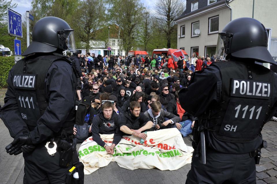 Police control participants of a sit-in as they block a street to protest against an election campaign of the German right-wing party NDP in Neumuenster, northern Germany, Tuesday, May 1, 2012. (AP Photo/dapd, Tim Riediger)