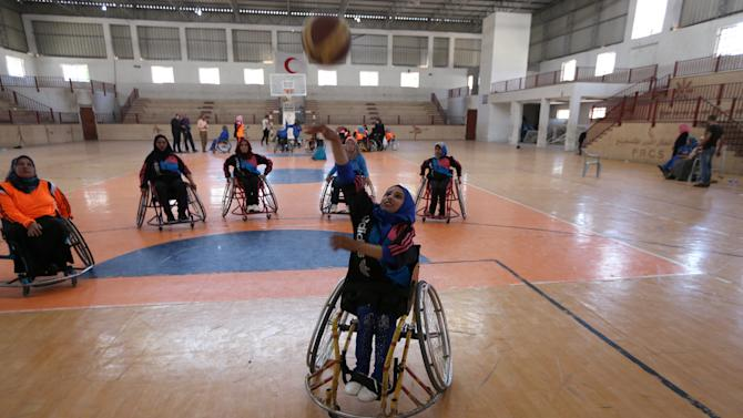 Jess Markt of the U.S. coaches disabled Palestinian women on wheelchair basketball during a training session organised by the International Committee of the Red Cross (ICRC) in Khan Younis in the southern Gaza Strip