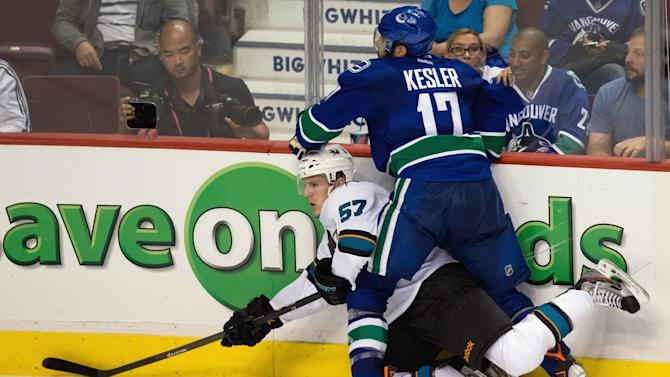Sharks edge Canucks 3-2 in preseason opener