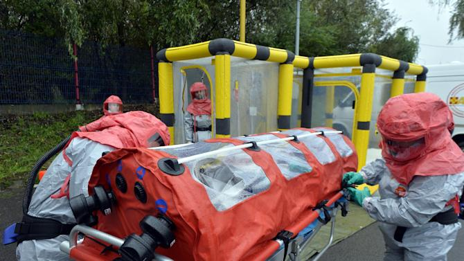 Rescue workers carry out an Ebola precautionary emergency exercise on October 23, 2014 in Vysne Nemecke, Slovakia