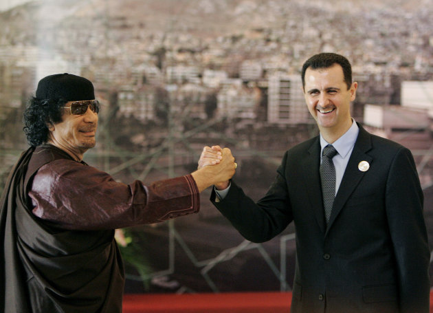 File-- In this March 2008 file photo, Libyan leader Moammar Gadhafi , left, gestures with Syrian President Bashar Assad, right, during the opening session of the Arab Summit in Damascus, Syria. When Bashar Assad inherited power in Syria in 2000, he was seen by many as a youthful new president in a region of aging dictators, a fresh face who could transform his father&#39;s stagnant dictatorship into a modern state. Now this once-popular image of Assad, as a reformer constrained by members of his late father&#39;s old guard, has vanished in the aftermath of one of the bloodiest government backlashes of the Arab Spring. (AP Photo/Hussein Malla, file)