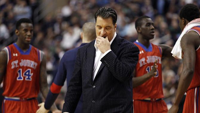 "FILE - In this Feb. 22, 2014, file photo, St. John's head coach Steve Lavin reacts as his team comes together for a timeout during the second half of an NCAA college basketball game against the Villanova in Philadelphia. St. John's announced Friday, March 27, 2015, it has ""mutually agreed to part ways"" with Lavin. He had one year left on his contract. (AP Photo/Chris Szagola, File)"