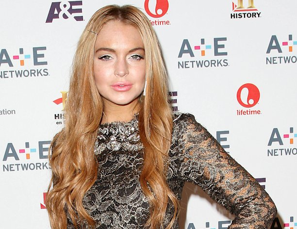 In this May 9, 2012 photo shows actress Lindsay Lohan at the A&E Networks 2012 Upfront at Lincoln Center in New York. Lohan will star as Elizabeth Taylor in the upcoming Lifetime TV movie &quot;Liz & Dick.&quot; Lohan was arrested in New York early Wednesday on charges that she clipped a pedestrian with her car and did not stop, police said. The 26-year-old actress was arrested at 2:25 a.m. as she left a nightclub at the Dream Hotel on 16th Street in Manhattan&#39;s Chelsea neighborhood, police said. They said no alcohol was involved. Lohan was charged with leaving the scene of an accident and causing injury. She was given a ticket and will have to appear in court at a later date. (AP Photo/Starpix, Kristina Bumphrey, file)