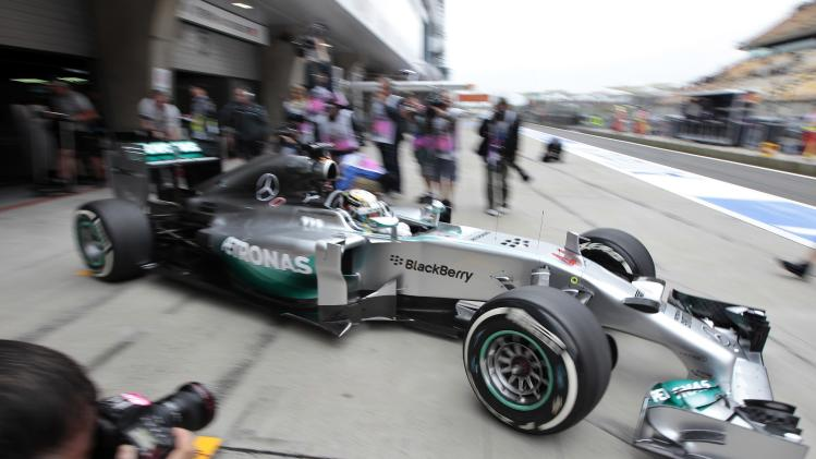 Mercedes Formula One driver Lewis Hamilton of Britain drives out of the team garage during the first practice session of the Chinese F1 Grand Prix at the Shanghai International circuit