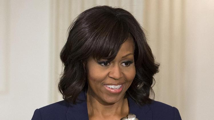 """First Lady Michelle Obama introduces a panel of the cast and crew of the movie """"42,"""" Tuesday, April 2, 2013, in the State Dining Room of the White House in Washington. (AP Photo/Jacquelyn Martin)"""