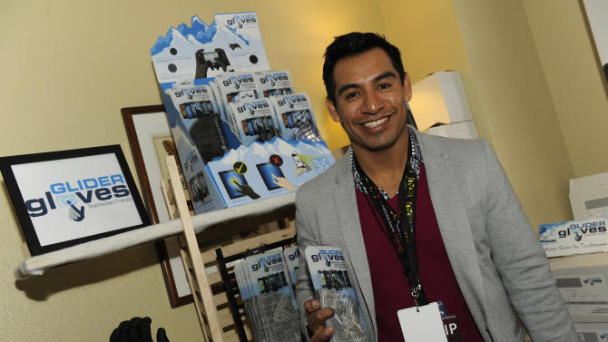 Actor Eloy Mendez visits the Glider Gloves booth at the Fender Music lodge during the Sundance Film Festival on Sunday, Jan. 20, 2013, in Park City, Utah. (Photo by Jack Dempsey/Invision for Fender/AP Images)