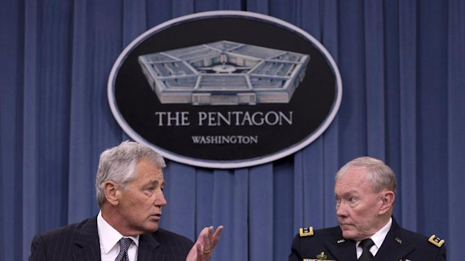 """Defense Secretary Chuck Hagel, left, accompanied by Joint Chiefs Chairman Gen. Martin Dempsey, gestures as he speaks during a news conference at the Pentagon, Friday, May 17, 2013. The Obama administration is criticizing Russia's decision to provide Syria with anti-ship missiles, which it says will only worsen the civil war. Dempsey said the missiles will embolden Syrian President Bashar Assad's regime and """"prolong the suffering."""" (AP Photo/Carolyn Kaster)"""