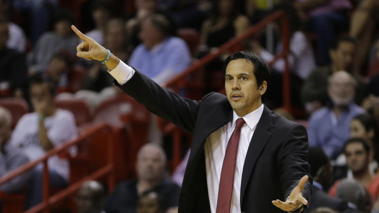 Miami Heat's coach Erik Spoelstra signals his team during the second half of a NBA basketball game in Miami, Friday, March 22, 2013 against the Detroit Pistons. The Heat won 103-89. (AP Photo/J Pat Carter)