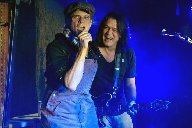 Van Halen members Eddie Van Halen, right, and David Lee Roth perform at Cafe Wha? in New York, Thursday, Jan. 5, 2012. (AP Photo/Charles Sykes)