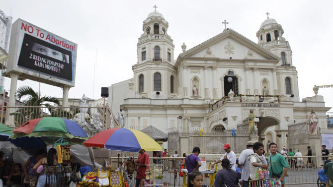 "A ""No to Abortion"" sign flashes on an electric signboard outside the Roman Catholic Minor Basilica of the Black Nazarene in downtown Manila, Philippines on Thursday, Jan. 3, 2013. Philippine President Benigno Aquino III last month signed the Responsible Parenthood and Reproductive Health Act of 2012. The law that provides state funding for contraceptives for the poor pitted the dominant Roman Catholic Church in an epic battle against the popular Aquino and his followers. (AP Photo/Aaron Favila)"