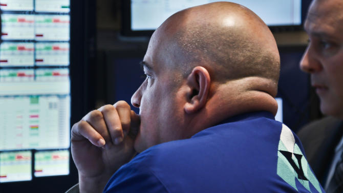 Anthony Confusione, a trader for Virtu Financial, monitors trading activity at his workstation at the New York Stock Exchange on Wednesday, Feb. 20, 2013.   Stock market indexes flipped between small gains and losses early after the U.S. government reported that housing construction slowed down during the first month of the year.  (AP Photo/Bebeto Matthews)