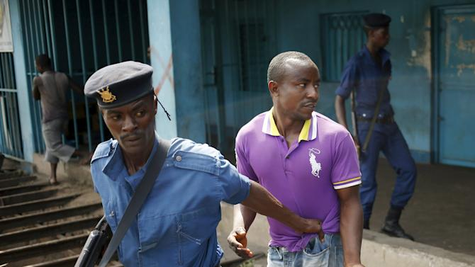 Policeman detains a protester during a protest against Burundi President Pierre Nkurunziza and his bid for a third term in Bujumbura