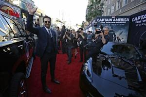 """Cast member Evans waves at the premiere of """"Captain America: The Winter Soldier"""" at El Capitan theatre in Hollywood"""