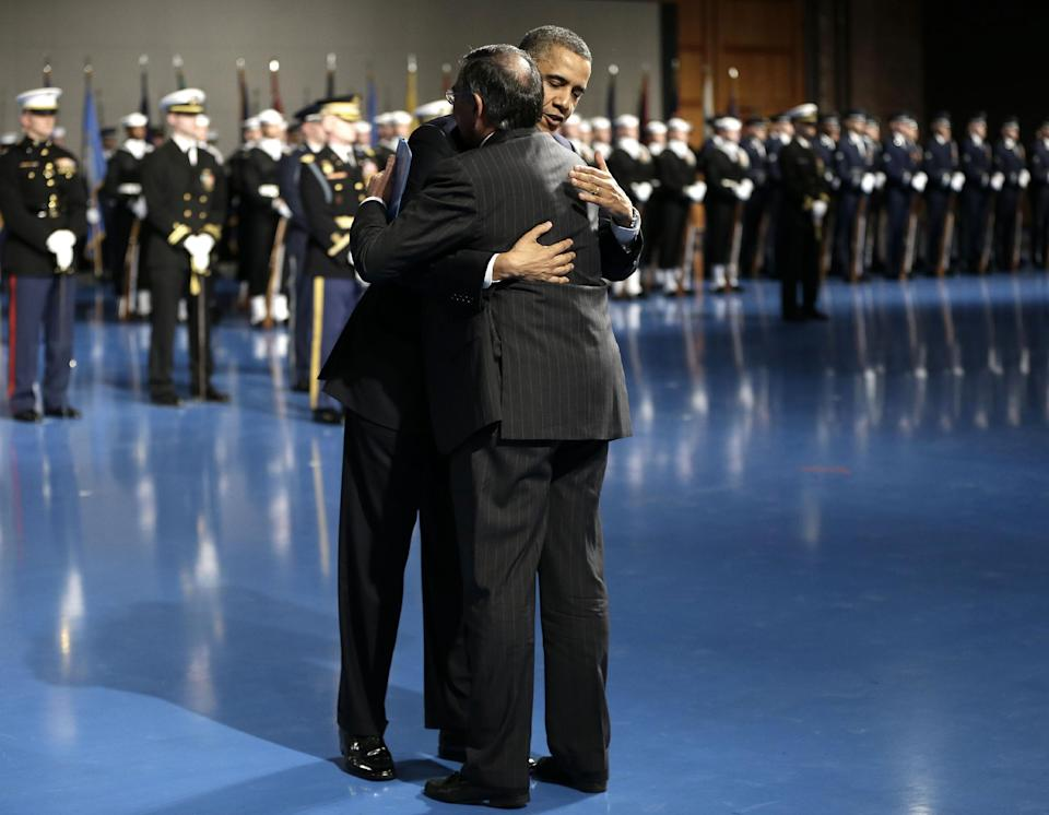 President Barack Obama hugs outgoing Defense Secretary Leon Panetta during a Farewell Tribute for Panetta, Friday, Feb. 8, 2013, at Joint Base Myer-Henderson Hall in Arlington, Va. (AP Photo/Pablo Martinez Monsivais)