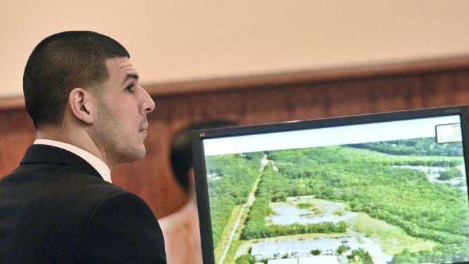 Former New England Patriots football player Aaron Hernandez views one of the exhibits on the screen during his trial in Fall River Massachusetts