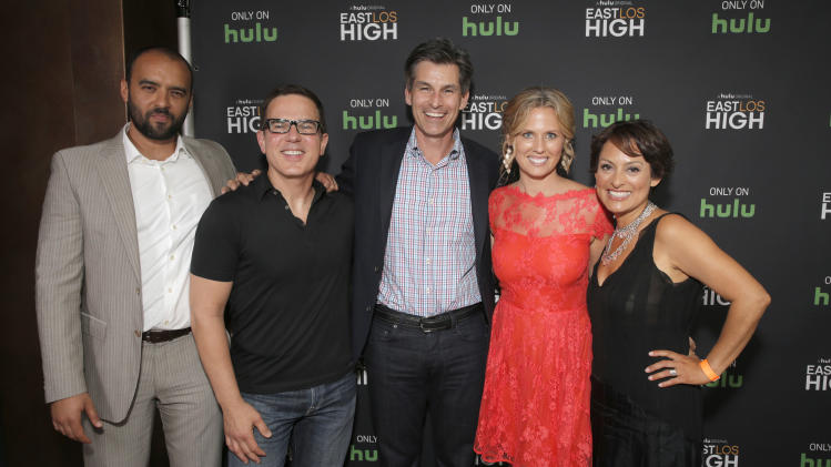 IMAGE DISTRIBUTED FOR HULU - Executive Producer Mauricio Mota, Co-Creator/Director Carlos Portugal, Hulu CEO Mike Hopkins, Executive Producer Katie Elmore Mota and Co-Creator Kathleen Bedoya attend Hulu's East Lost High Season 2 Premiere at Landmark Theater on Wednesday, July 9, 2014, in Los Angeles. (Photo by Todd Williamson/Invision for Hulu/AP Images)