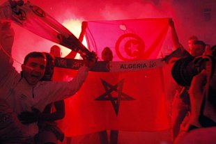 Algerian fans display flags as a show of pride during the celebration. (AP)