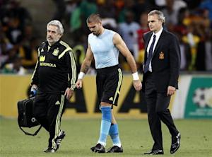 Spain's goalkeeper Valdes is escorted off the field during their international friendly soccer match against South Africa in Johannesburg