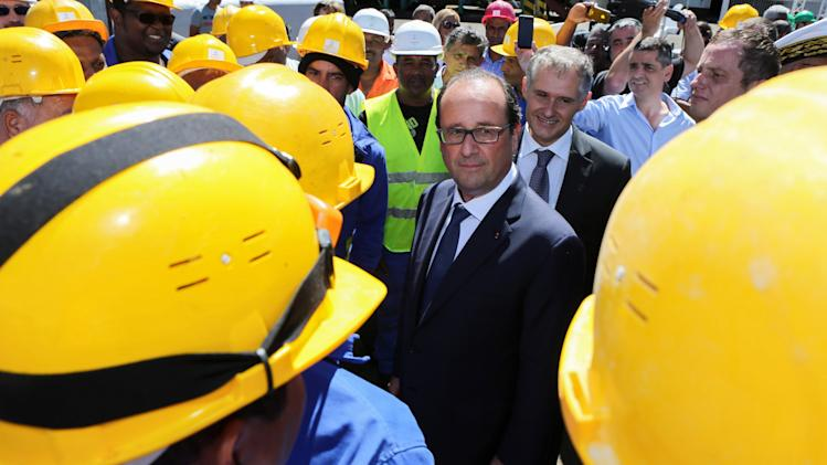 French President Hollande visits a sugar refinery in Bois-Rouge on the Indian Ocean island of La Reunion
