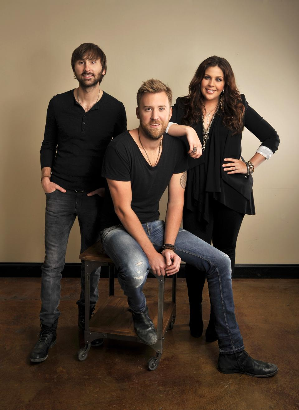 "This March 22, 2013 photo shows members of Lady Antebellum, from left, Dave Haywood, Charles Kelley and Hillary Scott in Nashville, Tenn., to promote their latest album, ""Golden."" (Photo by Donn Jones/Invision/AP)"
